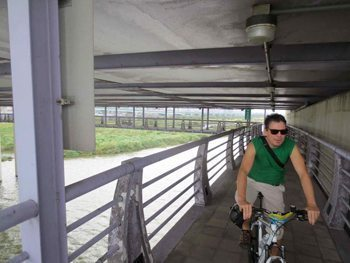 Riding below a highway in Taipei, Taiwan. photos by Larry Parnass.