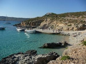 An excursion boat on the beach in Malta.