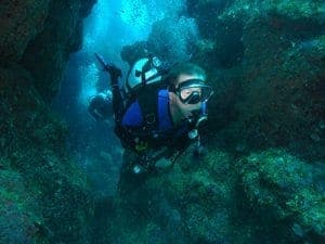 Phil navigates cliffs around Black Rock 1 dive site