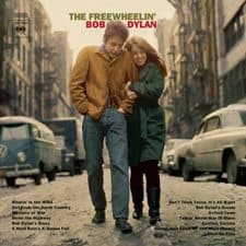 The album cover for The Freewheelin' Bob Dylan. He is pictured with Suze Rotolo on Jones St.