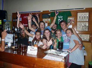Volunteer bar tenders at Adventure Brew Hostel in La Paz, Bolivia.