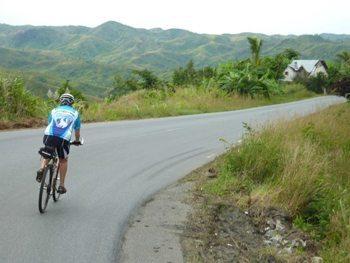 Biking down a curvy road in Madagascar.