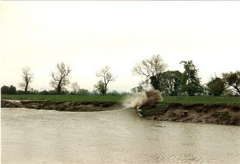 The bore hits the riverbank. photo Wikipedia.