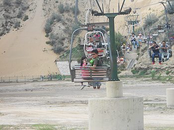 A cable car takes riders to the top of the hill to ride down on sledges.