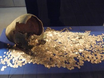 A coin hoard buried centuries ago on display at Trakai Island Castle
