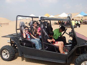 Buckling up in a jeep for a ride through the resonant sand desert.