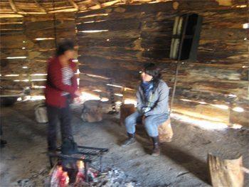 Inside a Mapuche hut, tourists mix with natives.