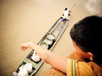Fish for sale alongside the cargo ship.