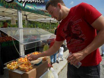 Sampling fruit at the Sunday farmer's market in Beverly Hills.