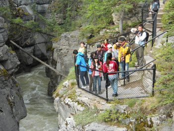 Viewing the gorge of the Maligne River
