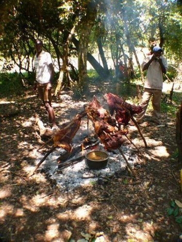 Grilling meats in the jungle with Maasai men: no women allowed.
