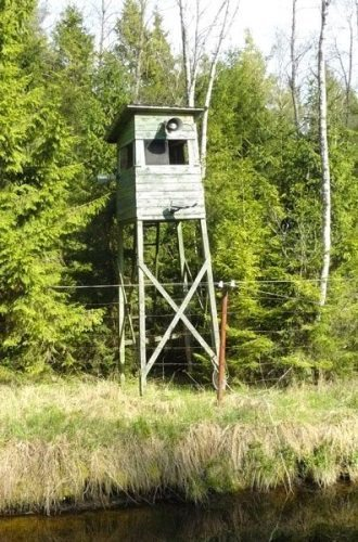 The camp has guard towers, barbed wire and a moat, reminiscent of the Soviet gulags.