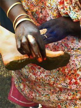 Applying henna paste to the feet is part of the elaborate ritual in Sudan.