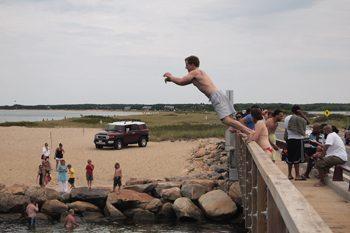 Jumping off the bridge at State Beach, Oak Bluffs.