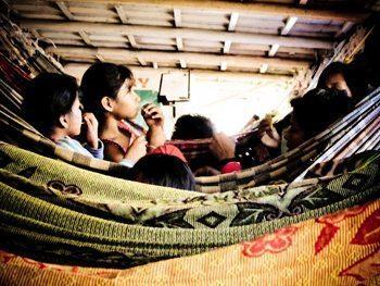 Kids slept on hammocks down below.