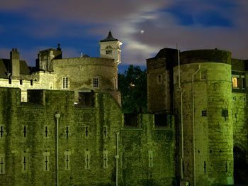 The Tower of London at night, where you can learn about England's darker history.