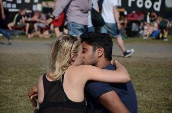 Sharing a kiss at the Roskilde Music Festival in Denmark. Connie Westergaard photos.