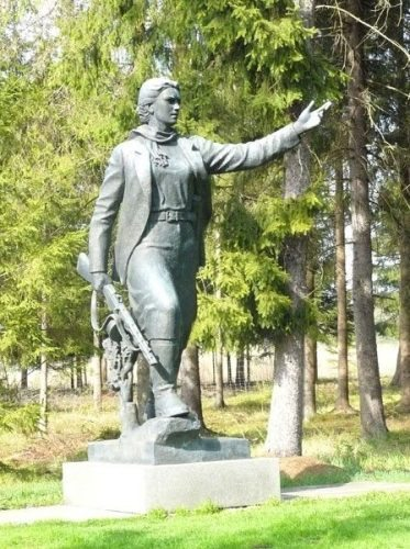 This is a statue dedicated to Maryt? Melnikait?, a partisan tortured and killed by the Nazis. The Soviets later needed a Lithuanian hero, so they gave her a Lithuanian name.