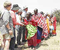 Maasai women with westerners.