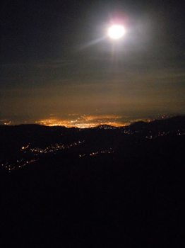 The lights of Kingston from the mountains during a moonlight hike.