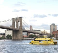 New York City water taxi and the famous Brooklyn Bridge in New York City. photo by Kyle McCarthy.