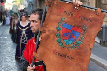An ancient shield at a feast parade in Tarquinia, Italy. photos by Daniel Foster.