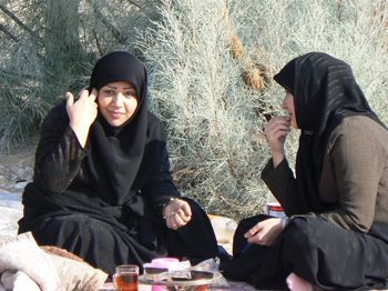 Picnickers are common sites in Iran, here two women enjoy lunch in the desert. Max Hartshorne photo.