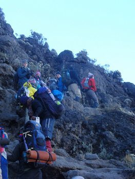 Scrambling up rocks on Mt Kilimanjaro. photos by Jessie Waack.