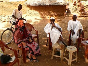 Newly decorated Andrea sitting with the village chief and his brother.