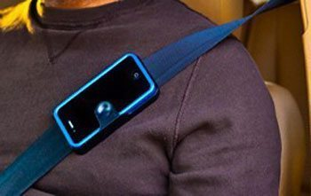 The Strap Caddy that lets you hook your phone to your seatbelt.
