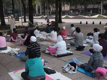 Yoga on the sidewalk on Sunday morning in Mexico City.