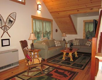 The quaint living room of White Birch Cottage