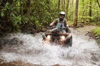 Bluff Mountain ATVs, fording a stream.