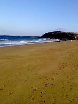 Arrieta Beach, Lanzarote. Red flags indicate it's not safe for swimming