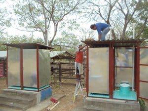 Volunteers building latrines in the village.
