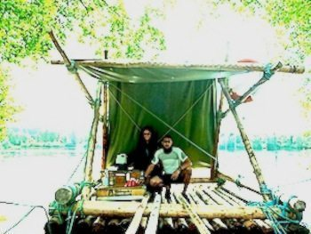 Gemma Frankland and Russell Rafton on their hand-built timber raft.
