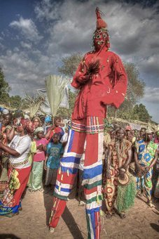 A Stilt dancer leads the procession for a boys initiation ceremony. photos by Simon Fenton.