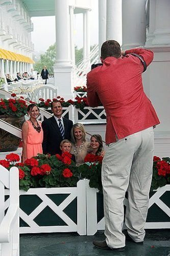 Family photo-op on the front porch of the Grand Hotel.