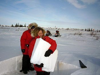Travel writer Kim Schneider helps build an igloo.