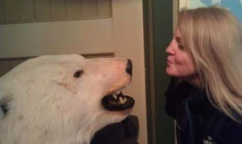 Janis Turk kisses a polar bear at the Churchill Railway Station Museum - Photo by Stephen A. Nelson