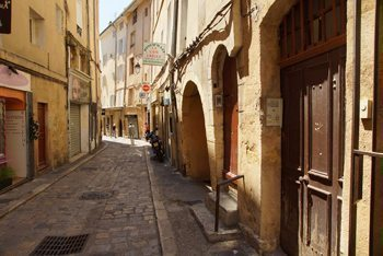 A typical winding cobblestone street in Aix's old town.