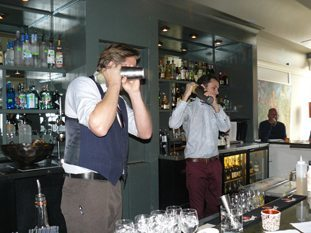 Joel Finsel and Ian Murray, the bartenders at Manna, demonstrate the fine points of mixology.