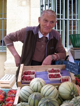 . A farmer selling melons and raspberries at Aix's daily food market in Place Richelme.