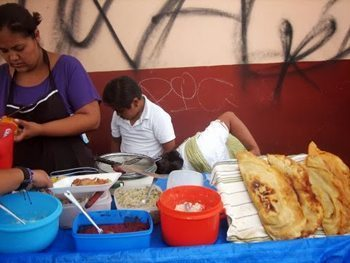 Street vendor and family, Puebla.