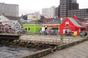 Halifax waterfront features a 3 kilometer boardwalk and ships.