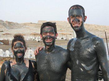 Mud baths on the beach in Romania.