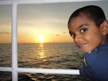 A boy on deck in the Maldives sunset. photos by Donna Richardson.