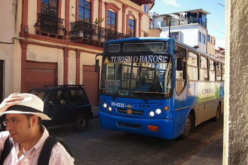 In Cuenca, the buses come very close to the people on the sidewalks. Soon a tram will replace many of these diesel buses.