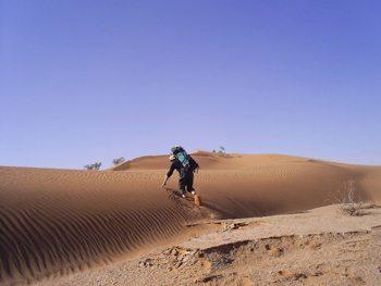 Climbing a dune in Morocco's vast Sahara desert. photos by Chris Watson