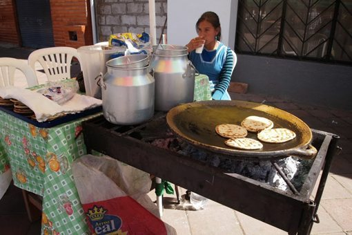 Corn cakes hot on a griddle, a specialty of the country near Quito.